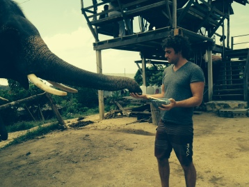 Mike feeding our elephant after 30 minute trek