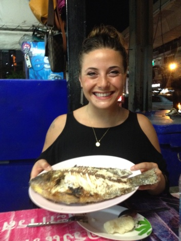 We ate a fresh whole fish at a street vendor on the sidewalk in Bangkok