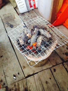 Cooking our fresh catch on the boat to Koh Ta Kiev